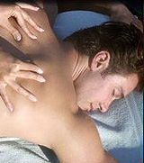 Photo of a man lying on a table getting a massage