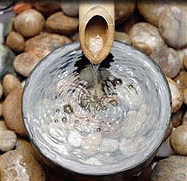 Photo of water flowing into bowl with rocks